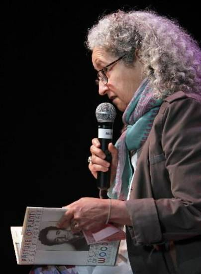Nora Guthrie, daughter of Woody Guthrie, reads a passage from a poem written by her dad in the audtorium of the Woody Guthrie Center the day before it opens to the public at the Guthrie Green/Brady District in Tulsa, OK, Apr. 26, 2013. Photo by Michael Wyke/Tulsa World