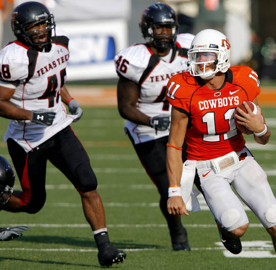 OSU quarterback Zac Robinson (11) runs upfield past Texas Tech's Paul Williams (48) and Sandy Riley during the second half of the college football game between the Oklahoma State University Cowboys (OSU) and the Texas Tech University Red Raiders (TTU) at Boone Pickens Stadium  on Saturday, Sept. 22, 2007, in Stillwater, Okla. 