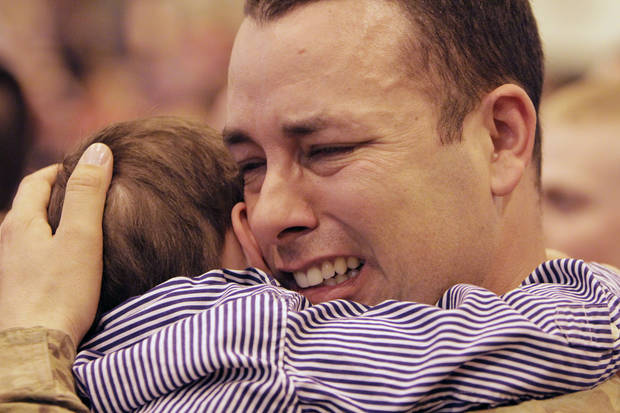 Sgt. Thomas Leach hugs his two-year-old son Noah, as soldiers from the 45th return from a year's deployment in Afghanistan to waiting family members in Oklahoma City, OK, Saturday, March 3, 2012. By Paul Hellstern, The Oklahoman