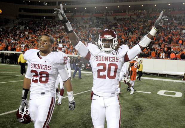 Oklahoma's Travis Lewis (28) and Quinton Carter (20) celebrate the Sooner's win of the college football game between the University of Oklahoma Sooners (OU) and Oklahoma State University Cowboys (OSU) at Boone Pickens Stadium on Saturday, Nov. 29, 2008, in Stillwater, Okla. STAFF PHOTO BY SARAH PHIPPS