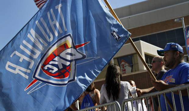 Thunder fan Carlos Garcia waves his Thunder flag while in Thunder Alley before  game 3 of the Western Conference Finals of the NBA basketball playoffs between the Dallas Mavericks and the Oklahoma City Thunder at the OKC Arena in downtown Oklahoma City, Saturday, May 21, 2011. Photo by Chris Landsberger, The Oklahoman