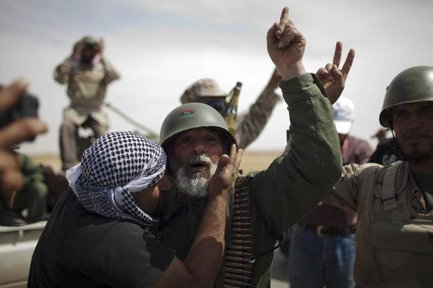 Rebel fighters celebrate after coming back  from the front line against  Moammar Gadhafi's forces, in Ajdabiya, Libya, Monday, May 9, 2011.  (AP Photo/Rodrigo Abd) ORG XMIT: ABD107