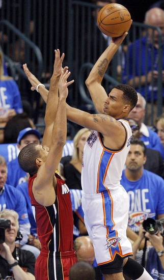 Oklahoma City's Thabo Sefolosha (2) shoots over Miami's Shane Battier (31) during Game 1 of the NBA Finals between the Oklahoma City Thunder and the Miami Heat at Chesapeake Energy Arena in Oklahoma City, Tuesday, June 12, 2012. Photo by Nate Billings, The Oklahoman