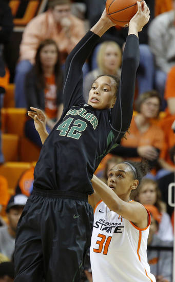 Baylor's Brittney Griner (42) grabs the ball over Oklahoma State's Kendra Suttles (31) during a women's college basketball game between Oklahoma State University and Baylor at Gallagher-Iba Arena in Stillwater, Okla., Saturday, Feb. 2, 2013. Photo by Bryan Terry, The Oklahoman
