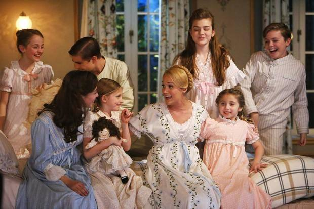 "From left, Sophia Ann Caruso as Brigitta, Ariane Rinehart as Liesl, Michael Nigro as Friedrich, Grace Rundhaug as Marta, Carrie Underwood as Maria, Ella Watts-Gorman as Louisa, Peyton Ella as Gretl, and Joe West as Kurt, in ""The Sound of Music Live!"""