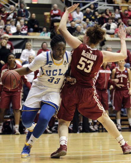 UCLA's Jasmine Dixon (33) drives the baseline against Oklahoma's Joanna McFarland during the first half of a second-round game in the women's NCAA college basketball tournament, Monday, March 25, 2013, in Columbus, Ohio. (AP Photo/Jay LaPrete) ORG XMIT: OHJL102