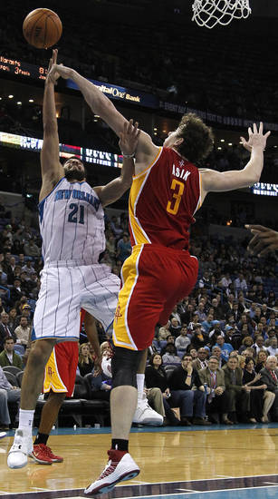 New Orleans Hornets point guard Greivis Vasquez (21) shoots the ball over Houston Rockets center Omer Asik (3) during the second half of an NBA basketball game in New Orleans, Wednesday, Jan. 9, 2013. The Hornets won 88-79. (AP Photo/Jonathan Bachman)