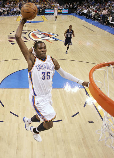 THE SCORING CHAMP :  Kevin Durant's dunk in this April 14 game against Memphis was part of a 31-point performance that made him the youngest scoring champion in NBA history. At age 21, he averaged 30.1 points.
