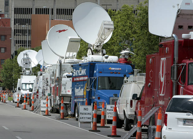 Satellite trucks are parked on June 13 along Robinson Avenue west of the Cox Convention Center ahead of the NBA Finals in Oklahoma City. Photo by  Steve Sisney,  The Oklahoman