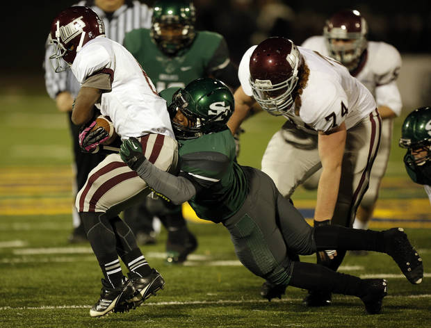 Santa Fe's Michael Fiberesima (9) takes down Memorial's Warren Wand (6) during a high school football game between Edmond Memorial and Edmond Santa Fe at Wantland Stadium in Edmond, Okla., Friday, Oct. 26, 2012.  Photo by Garett Fisbeck, The Oklahoman