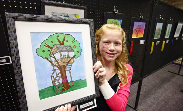Cross Timbers fifth-grader Halle McMullen  poses with her first place-winning tree art at Edmond's celebration of Arbor Week at the Edmond Library, March 26, 2012.  Photo By David McDaniel/The Oklahoman