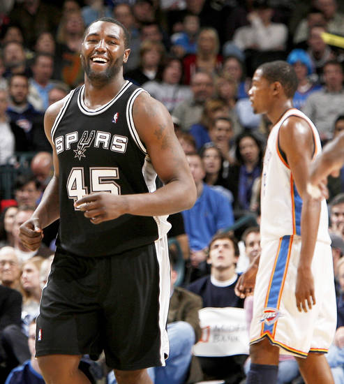 San Anotnio's DeJuan Blair smiles as Oklahoma City's Kevin Durant walks off the court following the Thunder's overtime loss. Blair started in the place of Tim Duncan, who was resting his aging knees. Photo by Bryan Terry, The Oklahoman