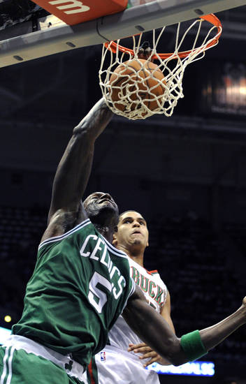 Boston Celtics' Kevin Garnett (5) dunks over Milwaukee Bucks' Tobias Harris during the first half of an NBA basketball game, Saturday, Nov. 10, 2012, in Milwaukee. (AP Photo/Jim Prisching)