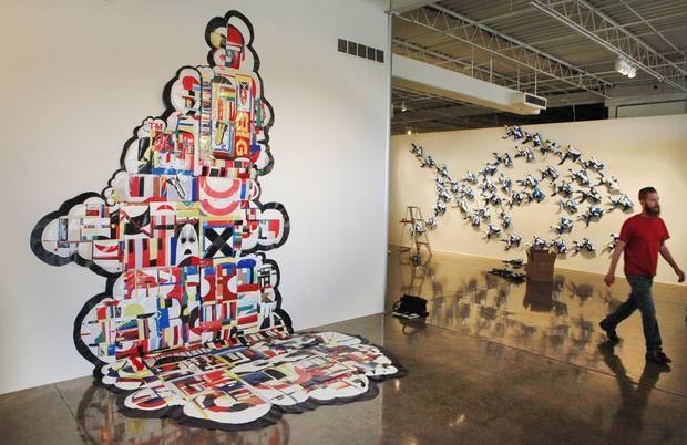 "Dallas-based artist Jason Willaford creates abstract artwork by sewing together pieces of vinyl reclaimed from billboards. His pieces ""Info-Nation Overload,"" left,"" and ""In Business for Small Business"" are featured in his exhibit ""Vinyl Exposed"" at Oklahoma Contemporary Arts Center."