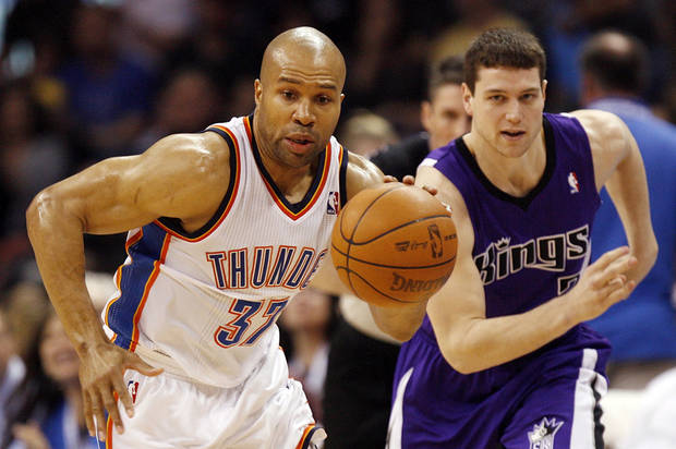 Oklahoma City's Derek Fisher (37) leads a fast break after stealing the ball from Sacramento's Jimmer Fredette (7) during the NBA basketball game between the Oklahoma City Thunder and the Sacramento Kings at Chesapeake Energy Arena in Oklahoma City, Friday, April 13, 2012. Oklahoma City won, 115-89. Photo by Nate Billings, The Oklahoman