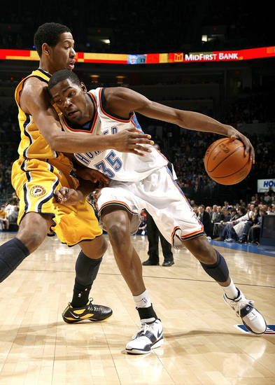 Oklahoma City's Kevin Durant (35) tries to get past Indiana's Danny Grander (33) during the basketball game between the Oklahoma City Thunder and the Indiana Pacers, Saturday, Jan. 9, 2010 at the Ford Center in Oklahoma CIty. Photo by Sarah Phipps, The Oklahoman