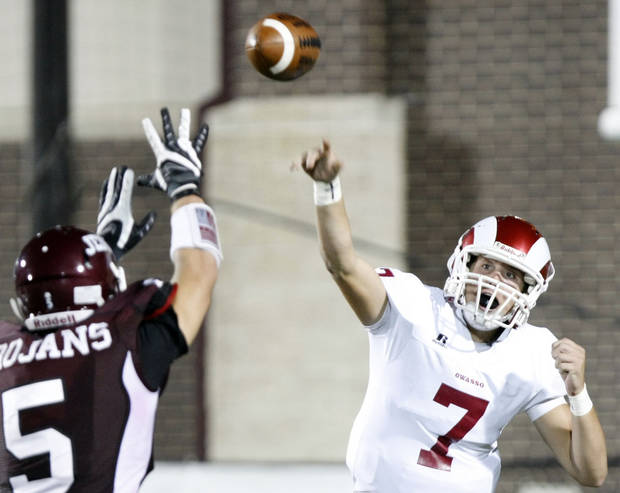 Owasso quarterback Kason Key (7) throws the ball past Jenks linebacker Trent Martin during a Class 6A football game between Jenks and Owasso, on Friday, Sept. 18, 2009. CORY YOUNG/Tulsa World