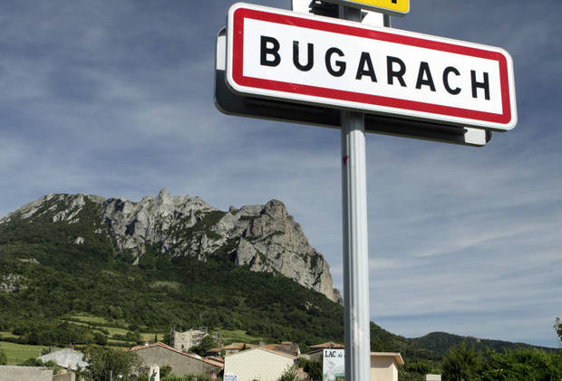 "This June 24, 2011 photo shows the Bugarach mountain peak in southern France. From Russia to California, thousands are preparing for the fateful day, when many believe a 5,125-year cycle known as the Long Count in the Mayan calendar supposedly comes to an end.  The Internet has helped feed the frenzy, spreading rumors that a mountain in the French Pyrenees is hiding an alien spaceship that will be the sole escape from the destruction.  French authorities are blocking access to Bugarach peak from Dec. 19-23 except for the village's 200 residents ""who want to live in peace,"" the local prefect said in a news release. (AP Photo)"