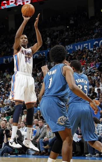 Oklahoma City&#039;s Kevin Durant (35) takes a shot over Nick young (1) and Trevor Booker (35) of Washington during the NBA basketball game between the Washington Wizards and the Oklahoma City Thunder at the Oklahoma City Arena in Oklahoma City, Friday, January 28, 2011. The Thunder won, 124-117, in double overtime. Photo by Nate Billings, The Oklahoman