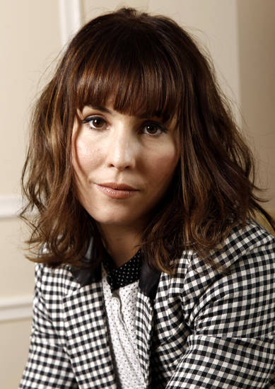 "In this Dec. 3, 2011 photo, actress Noomi Rapace, from the upcoming film ""Sherlock Holmes: A Game of Shadows"", poses for a portrait in Beverly Hills, Calif. The film opens in theaters Dec. 16, 2011. (AP Photo/Matt Sayles) ORG XMIT: NYET142"