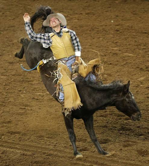 Jeremy Shed of Holdenville, Okla., rides in the bareback bronc competition during the International Finals Rodeo at Jim Norick Arena at State Fair Park in Oklahoma City, Saturday, Jan. 18, 20914. Photo by Bryan Terry, The Oklahoman