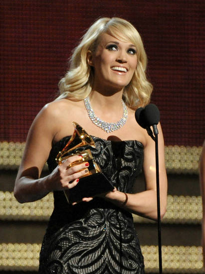 "Carrie Underwood accepts the award for best country solo performance for ""Blown Away"" at the 55th annual Grammy Awards on Sunday, Feb. 10, 2013, in Los Angeles. (Photo by John Shearer/Invision/AP) ORG XMIT: CAAR159"