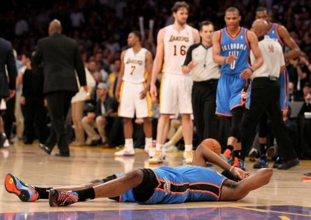 LOS ANGELES, CA - APRIL 22:  James Harden #13 of the Oklahoma City Thunder lies on the floor after being hit by Metta World Peace #15 of the Los Angeles Lakers as referees separate Thunder and Lakers players at Staples Center on April 22, 2012 in Los Angeles, California.  NOTE TO USER: User expressly acknowledges and agrees that, by downloading and or using this photograph, User is consenting to the terms and conditions of the Getty Images License Agreement.  (Photo by Stephen Dunn/Getty Images)