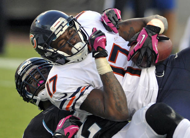 Chicago Bears wide receiver Alshon Jeffery, top, catches a pass for a 10-yard touchdown as he is tackled in the end zone by Jacksonville Jaguars cornerback Rashean Mathis, left, during the second half of an NFL football game, Sunday, Oct. 7, 2012, in Jacksonville, Fla. (AP Photo/Stephen Morton)