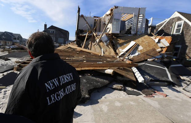 New Jersey Assembly Republican Leader Jon Bramnick walks near a home damaged by Superstorm Sandy, Thursday, Nov. 29, 2012, in Ortley Beach, N.J. The New Jersey General Assembly took a tour of areas hit a month after the storm. (AP Photo/Julio Cortez)