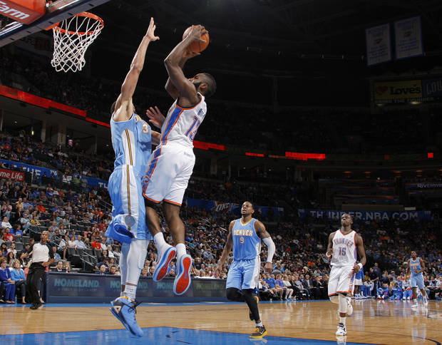 Oklahoma City's James Harden (13) takes a shot over Denver's JaVale McGee (34) during the NBA preseason basketball game between the Oklahoma City Thunder and the Denver Nuggets at the Chesapeake Energy Arena, Sunday, Oct. 21, 2012. Photo by Garett Fisbeck, The Oklahoman