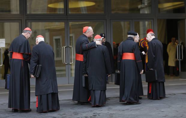 Cardinals, including U.S. Roger Mahony, left, and Timothy Dolan, third from left, arrive for a meeting at the Vatican, Monday March 11, 2013. Cardinals have gathered for their final day of talks before the conclave to elect the next pope amid debate over whether the Catholic Church needs a manager pope to clean up the Vatican&#039;s messy bureaucracy or a pastoral pope who can inspire the faithful and make Catholicism relevant again. (AP Photo/Alessandra Tarantino)