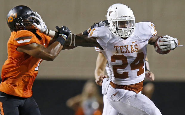Texas' Joe Bergeron (24) fights off Oklahoma State's Shamiel Gary (7) during a college football game between Oklahoma State University (OSU) and the University of Texas (UT) at Boone Pickens Stadium in Stillwater, Okla., Saturday, Sept. 29, 2012. Oklahoma State lost 41-36. Photo by Bryan Terry, The Oklahoman