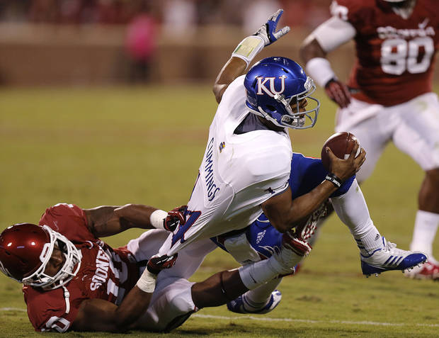 OU's Rashod Favors (10) sacks KU's Michael Cummings (14) during the college football game between the University of Oklahoma Sooners (OU) and the University of Kansas Jayhawks (KU) at Gaylord Family-Oklahoma Memorial Stadium on Saturday, Oct. 20th, 2012, in Norman, Okla. Photo by Chris Landsberger, The Oklahoman