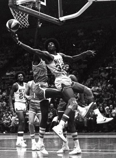Julius Erving hooks in a shot for the New York Nets against the Spirits of St. Louis in an ABA game from December 1975. (AP Photo)