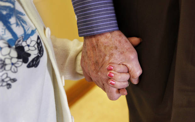 Resident Sharon Thompson holds the hand of Jim O'Brien at the 54-bed  facility, Center of Family Love, a group home for mentally disabled peopl,e in Okarche on Monday, Jan. 18, 2010. O'Brien is the center's executive director.   Photo by Jim Beckel, The Oklahoman