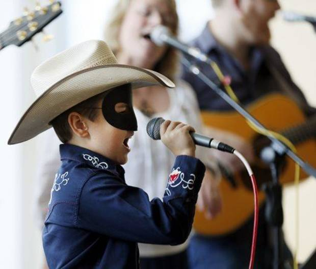 Maddox Ross, 9, sings as he wears a Lone Ranger mask during the 2013 National Day of the American Cowboy at the National Cowboy & Western Heritage Museum in Oklahoma City. Photo by Nate Billings, The Oklahoman Archives