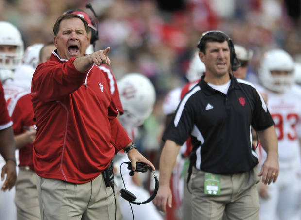 Indiana head coach Kevin Wilson, left, yells to his team during the first half of an NCAA college football game against Navy, Saturday, Oct. 20, 2012, in Annapolis, Md. Navy won 31-30. (AP Photo/Gail Burton). ORG XMIT: MDGB110