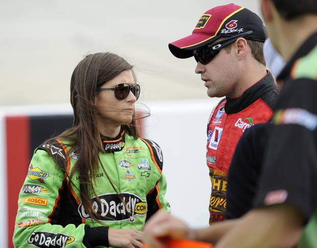 Nationwide Series driver Ricky Stenhouse Jr., right, talks with Danica Patrick, left, during qualifying for the OneMain Financial 200 NASCAR Nationwide Series auto race, Saturday, Sept. 29, 2012, in Dover, Del. (AP Photo/Nick Wass)