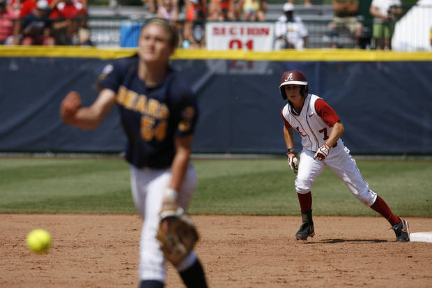 Alabama's Jennifer Fenton (7) leads off of second base while California's Jolene Henderson (54) pitches during a Women's College World Series game between Alabama and California at ASA Hall of Fame Stadium in Oklahoma City, Sunday, June 3, 2012.  Photo by Garett Fisbeck, The Oklahoman