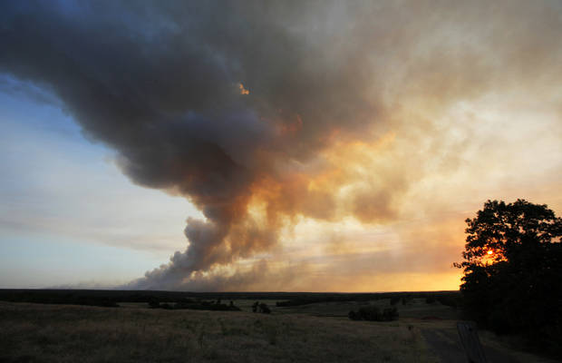 The view at sunset from SE 180th near Hwy 9 as a wildfire burns through Cleveland County near Norman, Okla., Friday, Aug. 3, 2012. Photo by Nate Billings, The Oklahoman