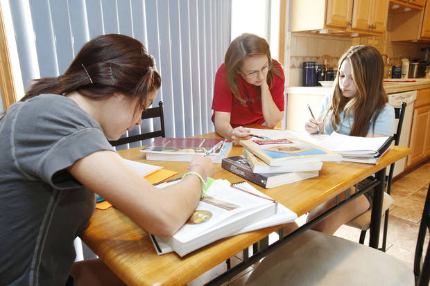 Johnni Dunford (center) works with her daughters Maddie, 17, (left) and Cassidy, 12, during homeschooling class time at their home in Edmond, OK, Tuesday, Aug. 31, 2010. By Paul Hellstern, The Oklahoman
