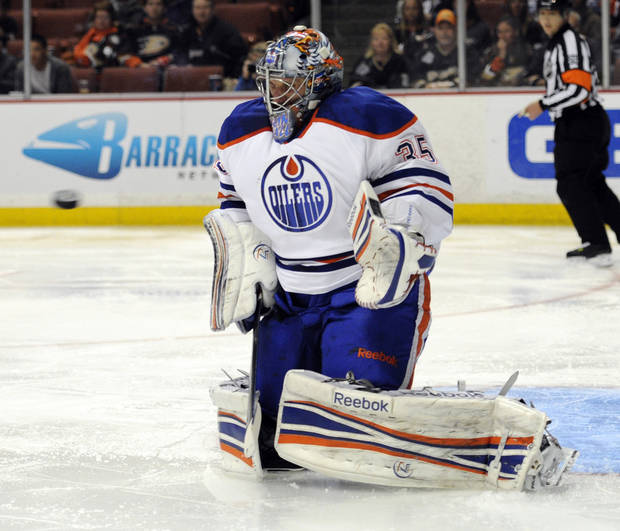 Edmonton Oilers goalie Nikolai Khabibulin (35), of Russia, stops a shot by the Anaheim Ducks in the second period of an NHL hockey game in Anaheim, Calif., Monday, March 5, 2012. (AP Photo/Lori Shepler)