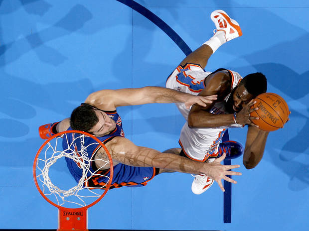Oklahoma City's James Harden (13) shoots the ball beside Josh Harrellson (55) during the NBA game between the Oklahoma City Thunder and the New York Knicks at Chesapeake Energy Arena in Oklahoma CIty, Saturday, Jan. 14, 2012. Photo by Bryan Terry, The Oklahoman