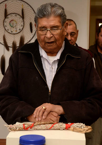 In this Saturday, Nov. 3, 2012 photo, Henry Anderson delivers a prayer during the grand opening of the Little Shell Chippewa Cree visitor center in Great Falls, Mont. (AP Photo/The Great Falls Tribune, Rion Sanders)
