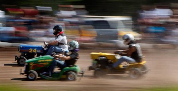 Mark Hall, left,  races in front of Jordan Macias, and Jim Petit during the El Reno Grascar Association lawn mower race in El Reno, Saturday, June 6, 2009. Photo by Bryan Terry, The Oklahoman