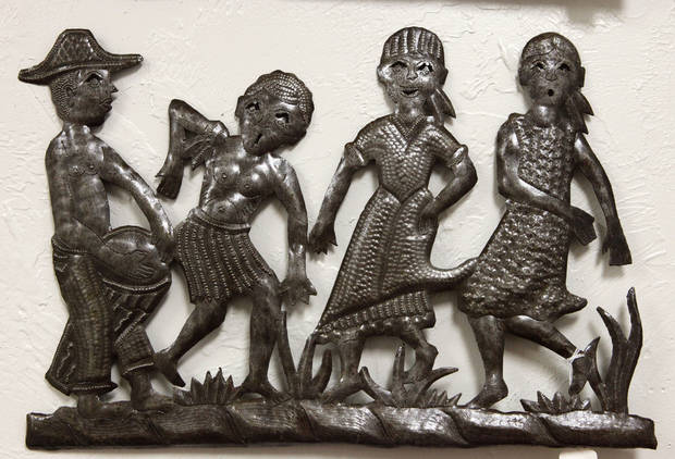 This metal wall hanging from Haiti is one of the items for sale at  Pambe Ghana Global Market. Photo By David McDaniel, The Oklahoman. <strong>David McDaniel - The Oklahoman</strong>