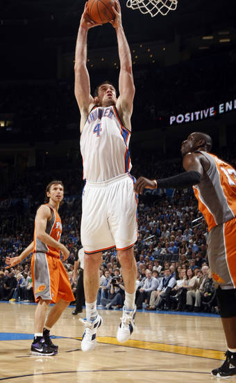 Oklahoma City's Nick Collison (4) shoots in front of Phoenix's Mickael Pietrus (12)during the NBA game between the Oklahoma City Thunder and the Phoenix Suns, Sunday, March 6, 2011, the Oklahoma City Arena. Photo by Sarah Phipps, The Oklahoman.