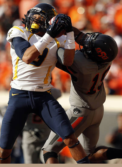 West Virginia's Stedman Bailey (3) catches a pass as Oklahoma State's Brodrick Brown (19) defends during a college football game between Oklahoma State University (OSU) and the West Virginia University at Boone Pickens Stadium in Stillwater, Okla., Saturday, Nov. 10, 2012. Photo by Sarah Phipps, The Oklahoman