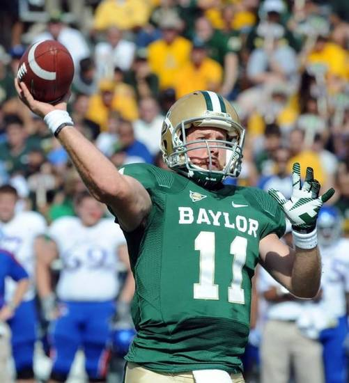 Baylor's quarterback Nick Florence (11) throws downfield against Kansas for a touchdown in the first half on Saturday, Nov. 3, 2012, in Waco, Texas. (AP Photo/Waco Tribune Herald, Rod Aydelotte)