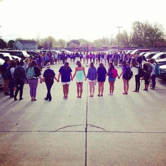 Prayer circle held at Norman North this morning for a senior, Audra Plusquellec, who is facing a life threatening illness. #PrayForAudra